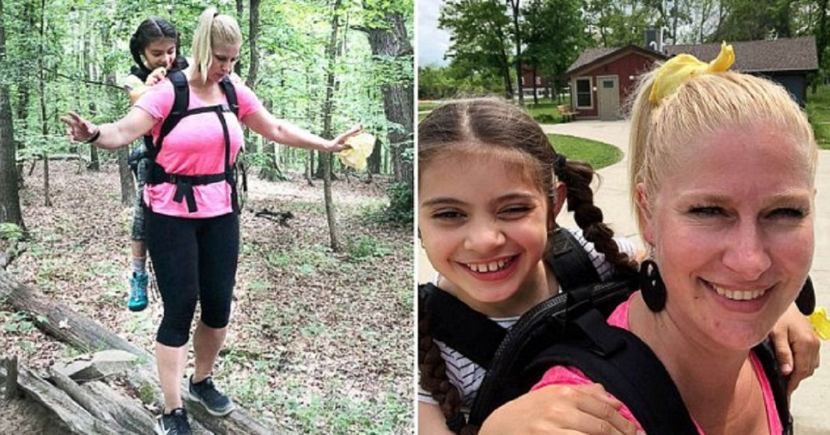 Chicago teacher carries student with cerebral palsy on her back on camping trip