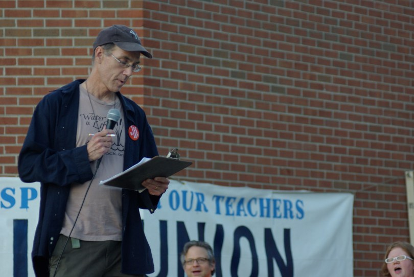 John Burger leads a chant at Ithaca College faculty union protest. Oct. 19, 2016. Photograph: Josh Brokaw.