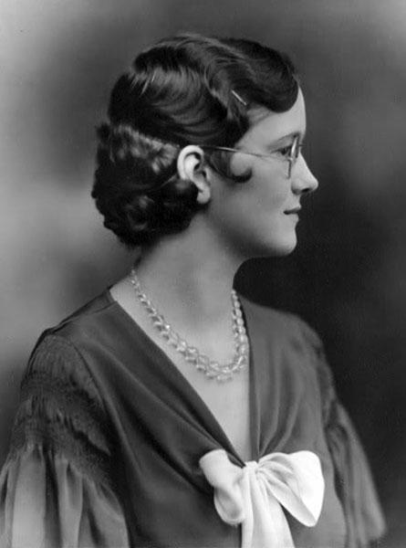 Woman wearing eyeglasses, 1920s.