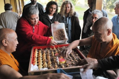 Helping filling a Stupa in Portugal