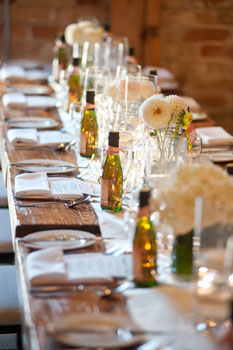 Florals run lengthwise down centre tables. Photo courtesy of Events In Bloom