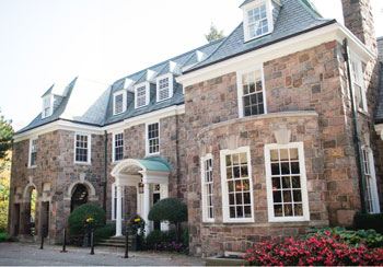 The fieldstone exterior of McLean House, part of the Estates of Sunnybrook