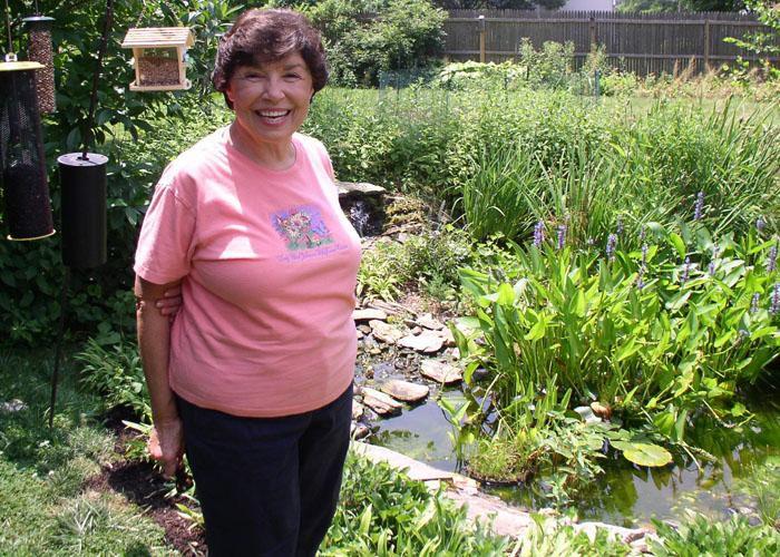 Cheryl Bittner standing in front of her pond