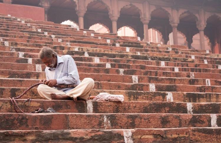 Man Working on Whip on Stairs of Jama Masjid - Old Delhi, India - Copyright 2016 Ralph Velasco