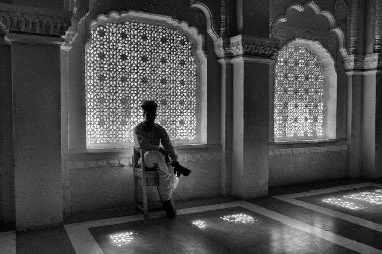 Man in Turban Sitting in Chair Silhouetted Against Window Screens - Jodhpur, India - Copyright 2016 Ralph Velasco
