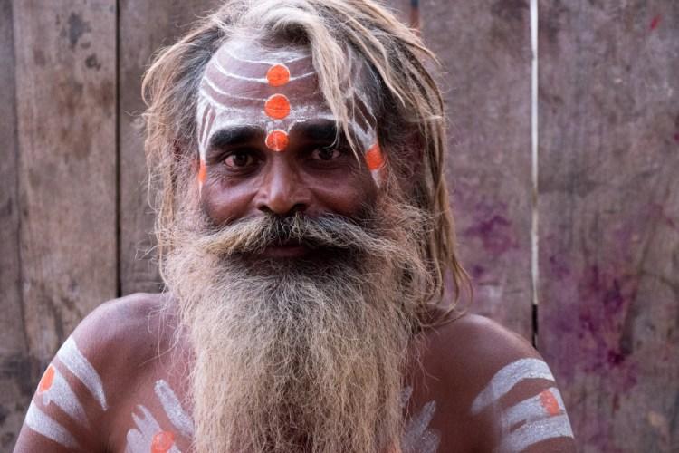 Sadhu Smiling Against Wood Wall - L - Varanasi, India - Copyright 2016 Ralph Velasco