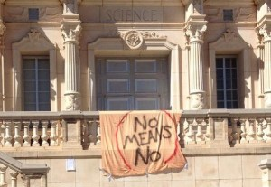 Students hung a spray painted bed sheet on the science building as part of the protest. Photo posted to Twitter by user @the_bone_lady.