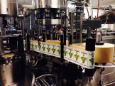 A machine that puts the labels on Llano Estacado wine bottles.