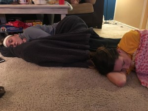 Two Kappa Alpha Theta members napping to pass the time during election night