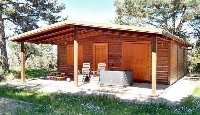 una casa de madera por un precio muy barato si es posible