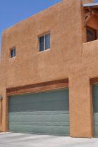 brightly colored garage doors are common in Civano