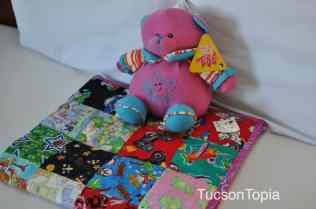 Each family receives a stuffed animal and handmade quilt, thanks to volunteers