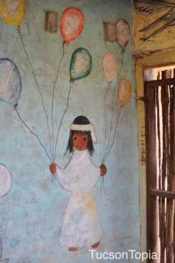 child with balloons by DeGrazia