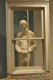 man behind the window at UA Museum of Art