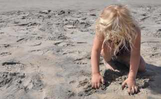 playing in the sand at Coronado Beach