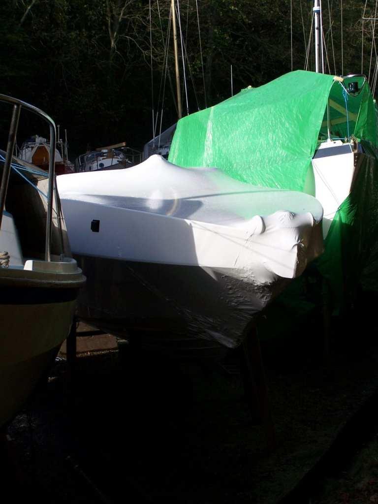 Shrink wrap or tarpaulin