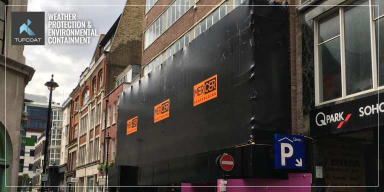Black scaffold shrink-wrap and vinyl stickers