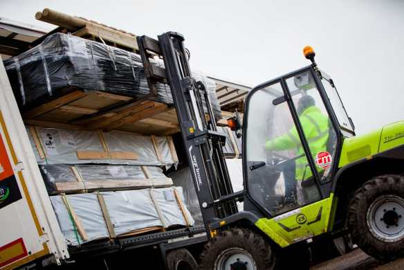 Unloading the lorries from Holland, the products are then checked and repacked for onward distribution across the UK.