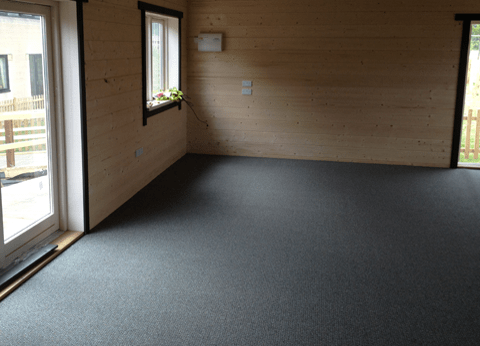 Carpeted log cabin floor. If you're going to do this do you really need a pine floor from us?