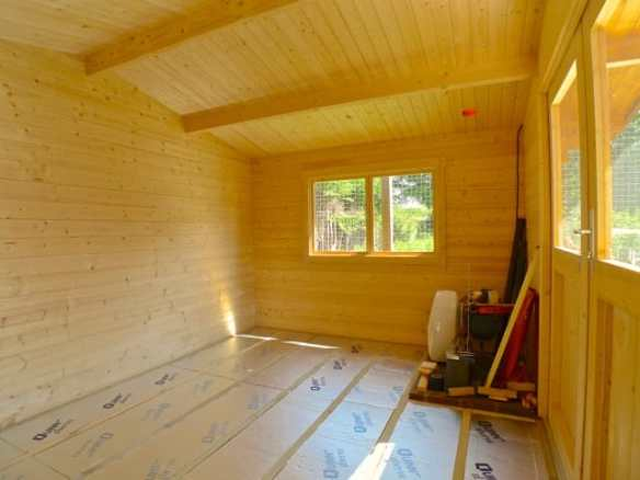Insulated log cabin floor ready for boards and the final floor covering.