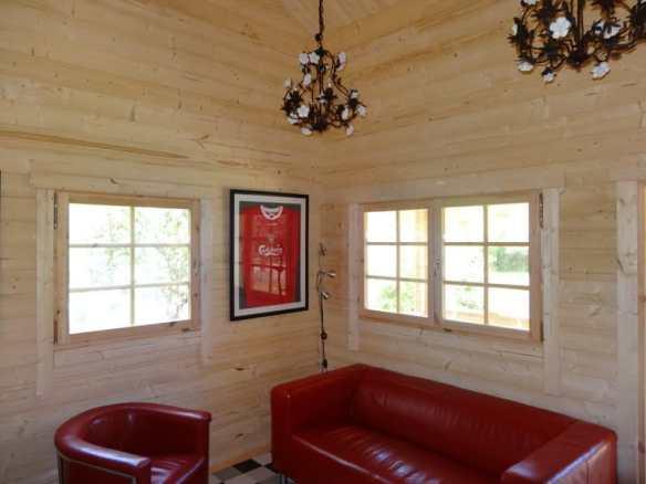 Looking inside Mr Teagues log cabin