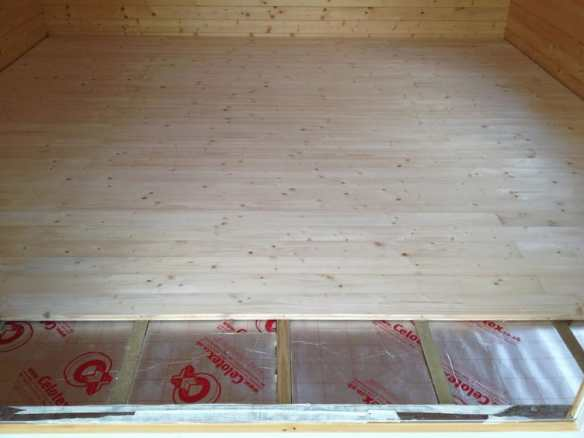 The laying of the floor is straightforward and is carried out after the build of the log cabin.