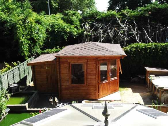 The Asmund corner log cabin with a shed extension log cabin accessory to the rear of the build.