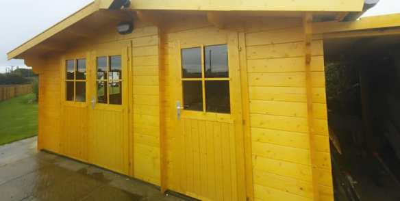 The Lukas log cabin with a shed integrated into it. Extremely handy