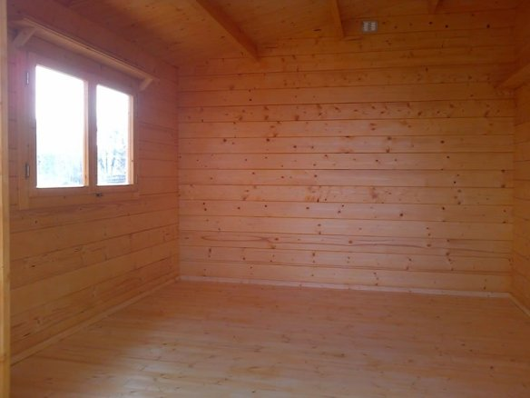 This is the basic inside of a log cabin with a floor fitted