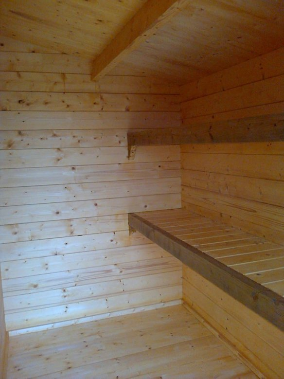 Lukas log cabin shed area, our customer has made great use of left over timber to product some shelves.