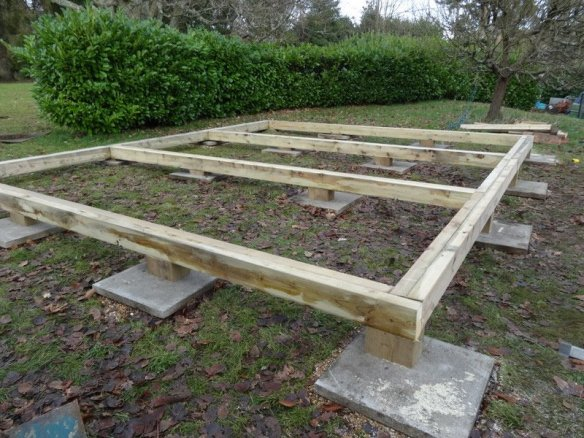 This is the start of a timber frame base for a log cabin. Notice the size of the timber we are using, this has been laminated together to form the frame.