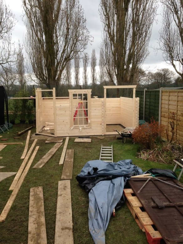 Windows and doors are slotted into place as the wall are built up