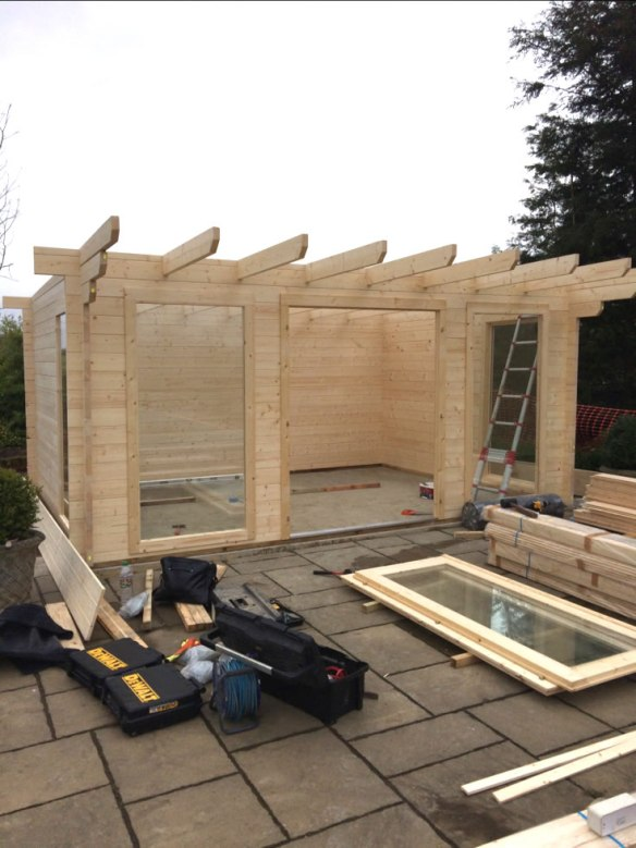 Philip installing one of our Yorick garden office log cabins.