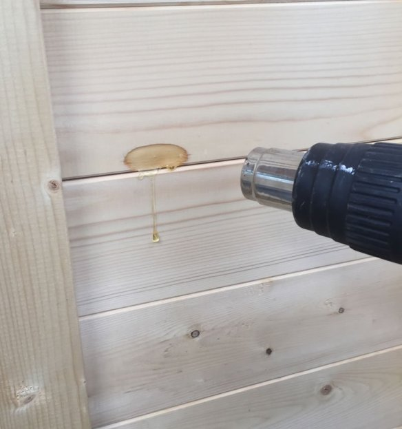 Using a heat gun or hair dryer you can liquify the sap pocket. As heat is applied it will start to flow out of the pocket