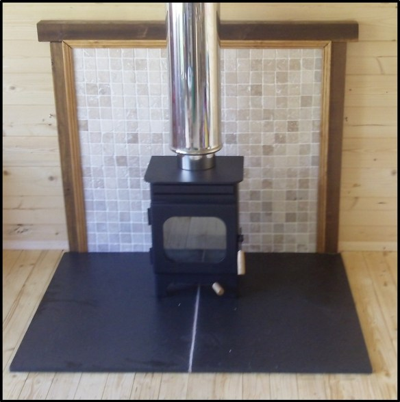 Woodburning stove in a log cabin