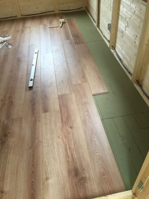 A stunning oak laminate floor fitted on top of the standard floor