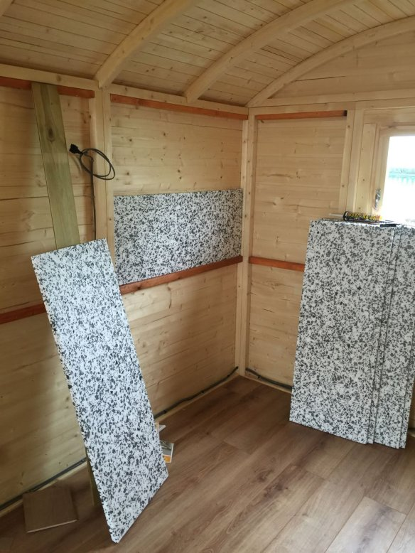 Insulation boards fitted in the wall panels.