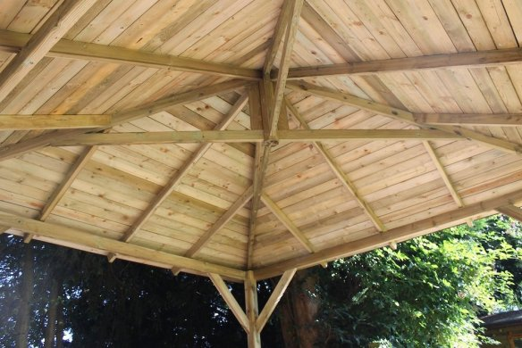 Square gazebo roof construction using truss type beams.