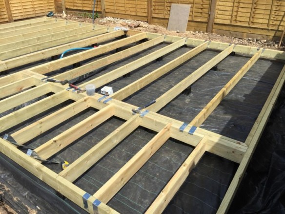 Joists installed with hangars. You could build a house on this frame, let alone a cabin!