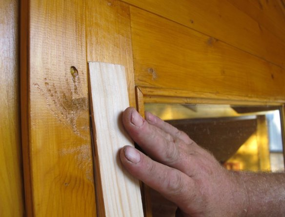 If you have a double door and have fitted a door stop trim then use a similar size piec e of timber