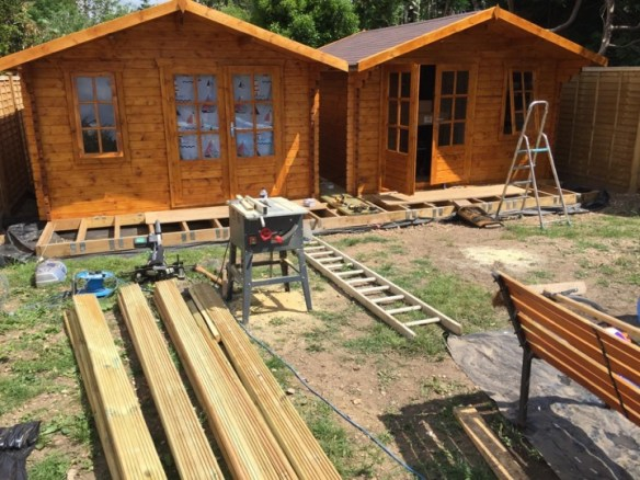 Cabins finished, time to deck the front. 144mm x 32mm Redwood planks in this case.