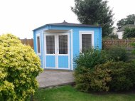 The Emma Log Cabin Painted Blue