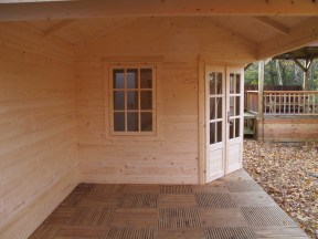 A Side View Of The Kennet Log Cabin