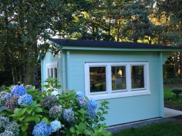 A Turquoise Painted Blackpool Log Cabin