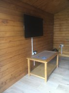 TV setup inside the Ulrik Log Cabin