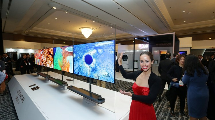1. A model poses next to LG's revolutionary new LG SIGNATURE W7 OLED 4K TV at Innofest 2017