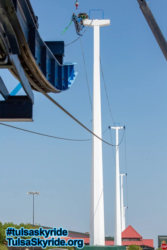 Tulsa Skyride tower 5 maintenance: The rope (cable) is now off of both sides of the tower. The remaining battery is under preparation for removal and lowering to the ground.