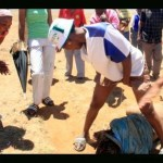 A South African Woman Urinating at a Rapist after being caught !