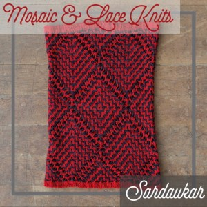A cowl combing slip stitch colorwork and lace.