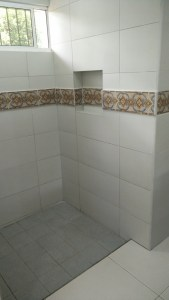 Some extra tile in the bathrooms to add a bit of color